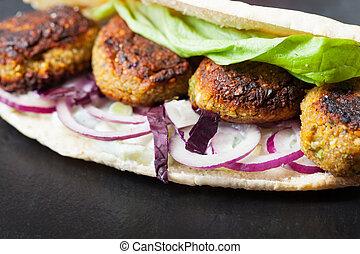 falafel sandwich with salad