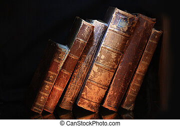 Old Books - Old books in a row isolated on dark background
