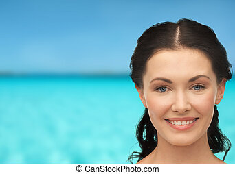 young laughing woman - health, spa and beauty concept -...