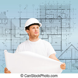 male architect looking at blueprint - building, developing,...