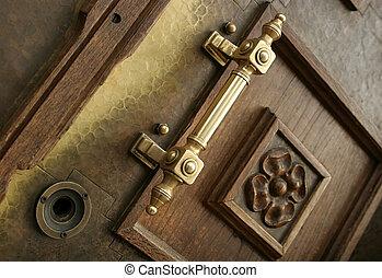 Brass doorknob - Interesting brass doorknob on a wooden...