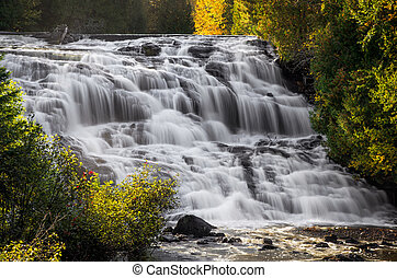 Bond Falls Cascade - Early morning light backlights the...