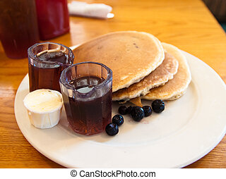 Blueberry Pancakes and Maple Syrup - Stack ofBlueberry...