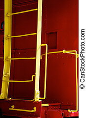 yellow ladder on red caboose - A bright yellow steel ladder...