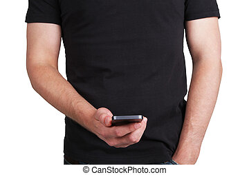 man with cellular phone - man in black t-shirt with cellular...
