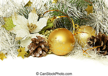 Christmas balls with tinsel, cones and artificial poinsettia...