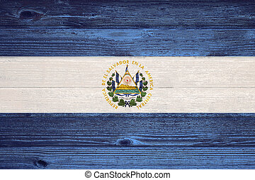 El Salvador Flag painted on old wood plank background. - El...