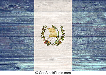 Guatemala Flag painted on old wood plank background -...