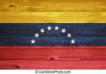 Venezuela Flag painted on old wood plank background. -...