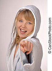 woman in bathrobe pointing at you