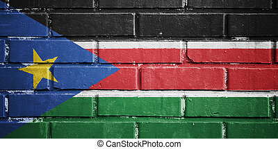 South Sudan flag on brick wall - South Sudan flag on texture...