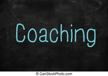 Coaching word written on a blackboard