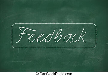 Feedback written on blackboard - Feedback written with chalk...