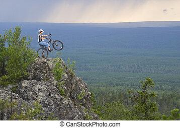 Biker at peak - Biker at Oldman-Stone peak, Sverdlovskaya...