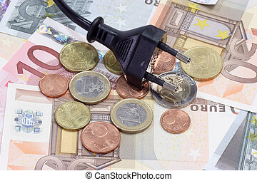Energy costs - European currency in coins and banknotes with...