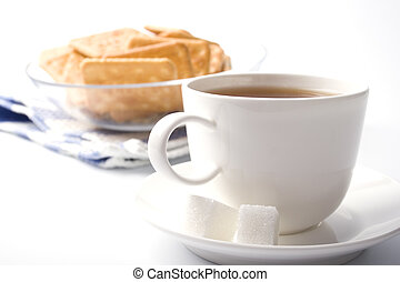 cup of tea, sugar and cookies closeup on white