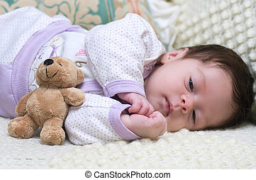 Cute funny infant baby with toy bea
