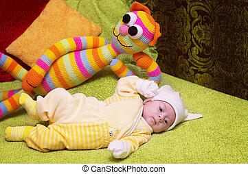 Cute funny infant baby with toy cat