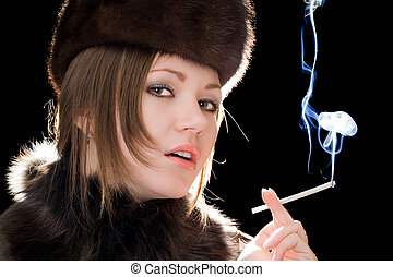 Portrait of the beautiful young woman with a cigarette