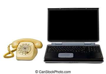 Laptop and old phone. Isolated on white