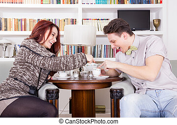 smiling couple sitting in chairs in the living room