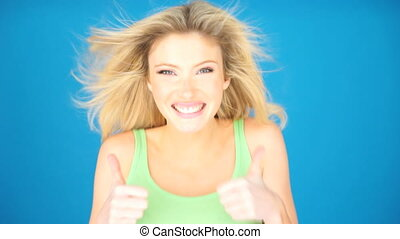 exited blonde woman on blue