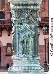 iron allegory at the fountain of justice in Frankfurt