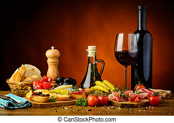 Traditional spanish tapas and red wine - still life with...