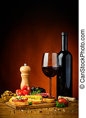Tapas snacks and red wine - still life with traditional...