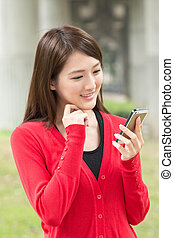 woman using smartphone - Attractive young Asian woman using...