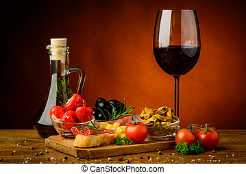 Tapas snacks and wine - still life with traditional tapas...