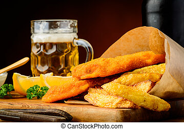 Fish and chips meal and beer - still life with fish and...