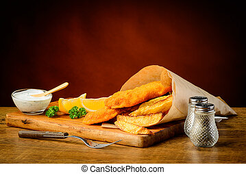 Delicious fish and chips meal - delicious traditional fish...