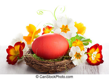Easter eggs - Easter egg in nest with spring flowers
