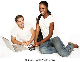happy couple - Couple shopping on internet paying by credit...