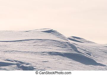 Snow hills on sunset