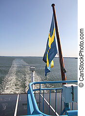 Swedish flag on stern of a large ship