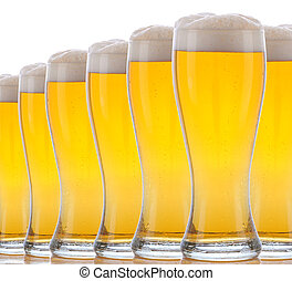 Closeup Glasses of Foamy Beer on a white background. The...