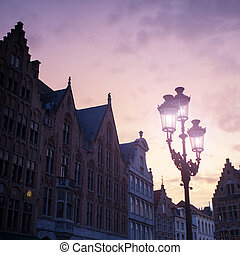 Silhouettes of city center houses in Bruges against...
