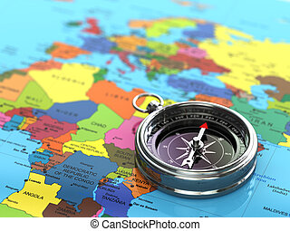 Silver compass  on world map background.