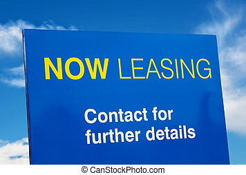 leasing - leaseing blue sign closeup over sky