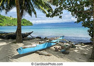 Outrigger on Kioa Island - A blue polynesian outrigger...