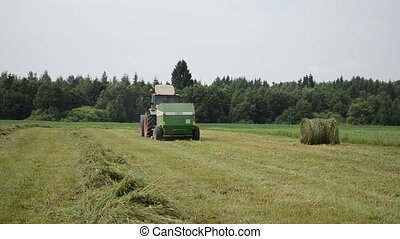 tractor collect hay field - tractor collect hay in field...