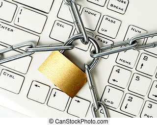 Virus protection - Computer keyboard locked with padlock and...