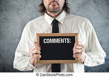 Businessman holding blackboard with comments Business poll