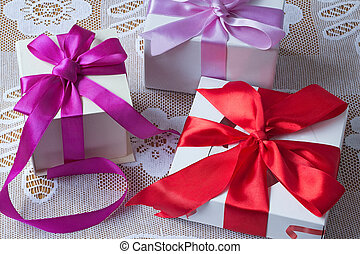 A beautifully decorated and tied with a ribbon box with a gift for the holiday, celebration, anniversary.