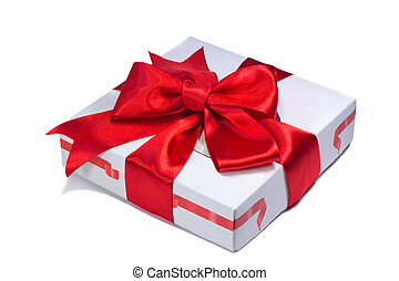 A beautifully decorated and tied with a ribbon box with a gift for the holiday, celebration, anniversary. Presents on a white background.