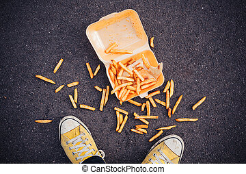 Man dropping his chips - Young man has dropped his chips in...