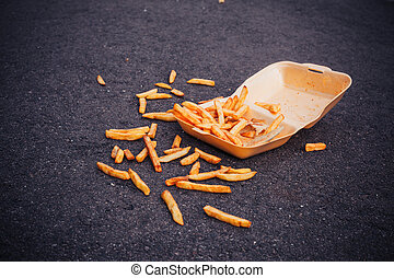 Box of chips on the ground - Box of chips spilled all over...