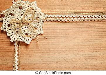 Background and crochet lace with tapes - Wooden background...